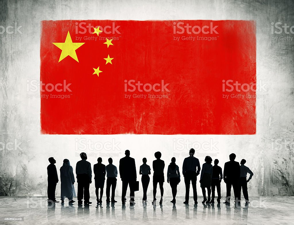 Business People Standing in front of the Flag of China stock photo