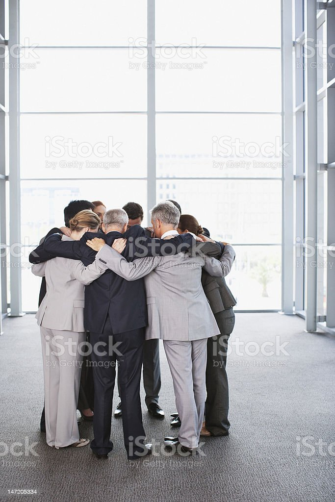 Business people standing in huddle royalty-free stock photo