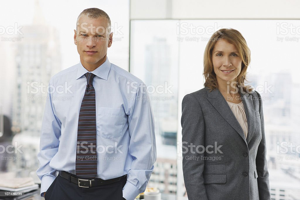Business people standing in office royalty-free stock photo