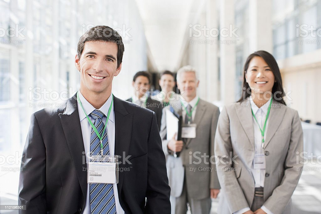 Business people standing in office stock photo