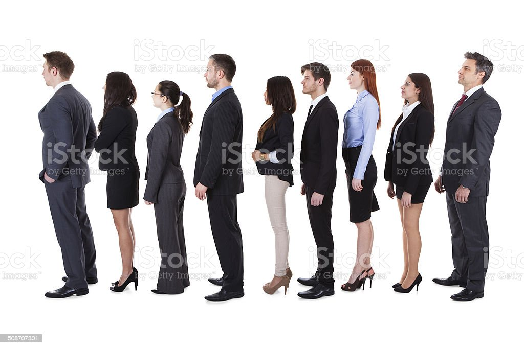 Business people standing in queue stock photo