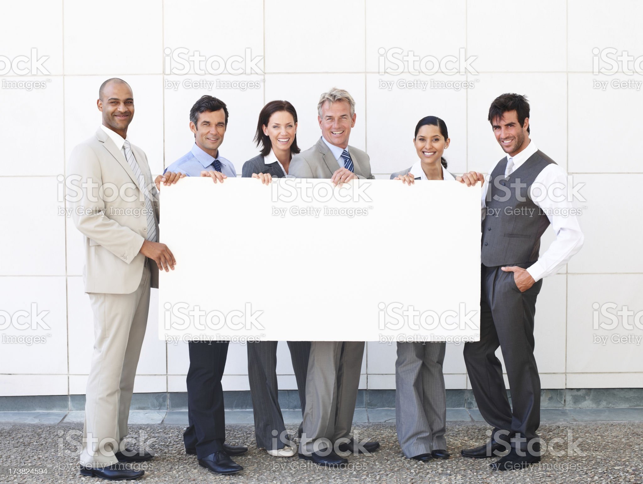 Business people standing together and holding placard royalty-free stock photo