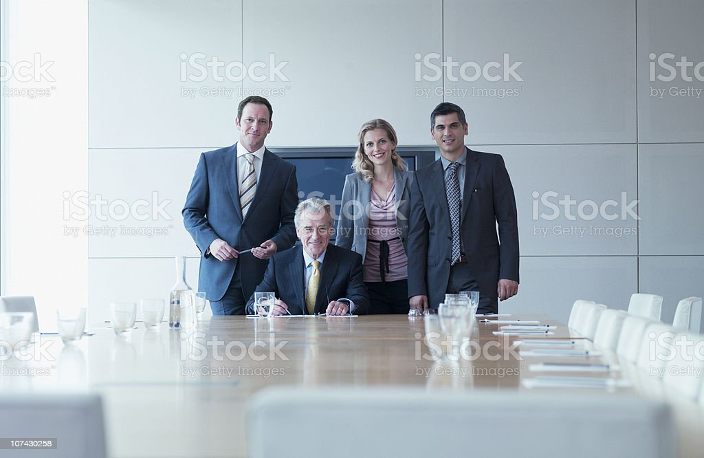 Business people standing together in conference room royalty-free stock photo