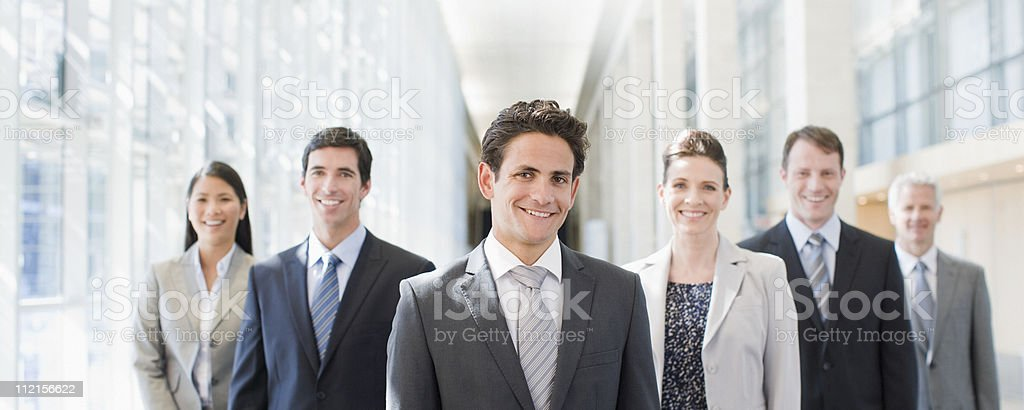 Business people standing together in office royalty-free stock photo