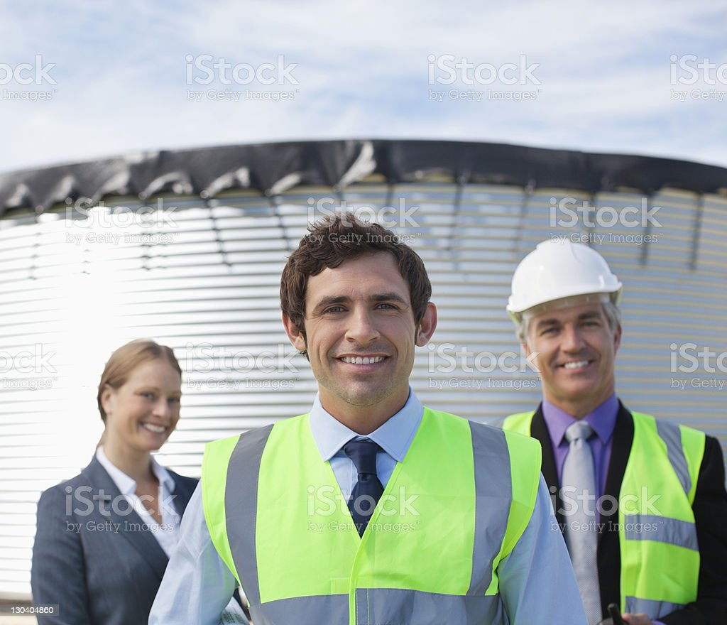 Business people standing together outdoors royalty-free stock photo