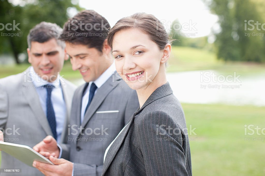 Business people standing together outdoors stock photo