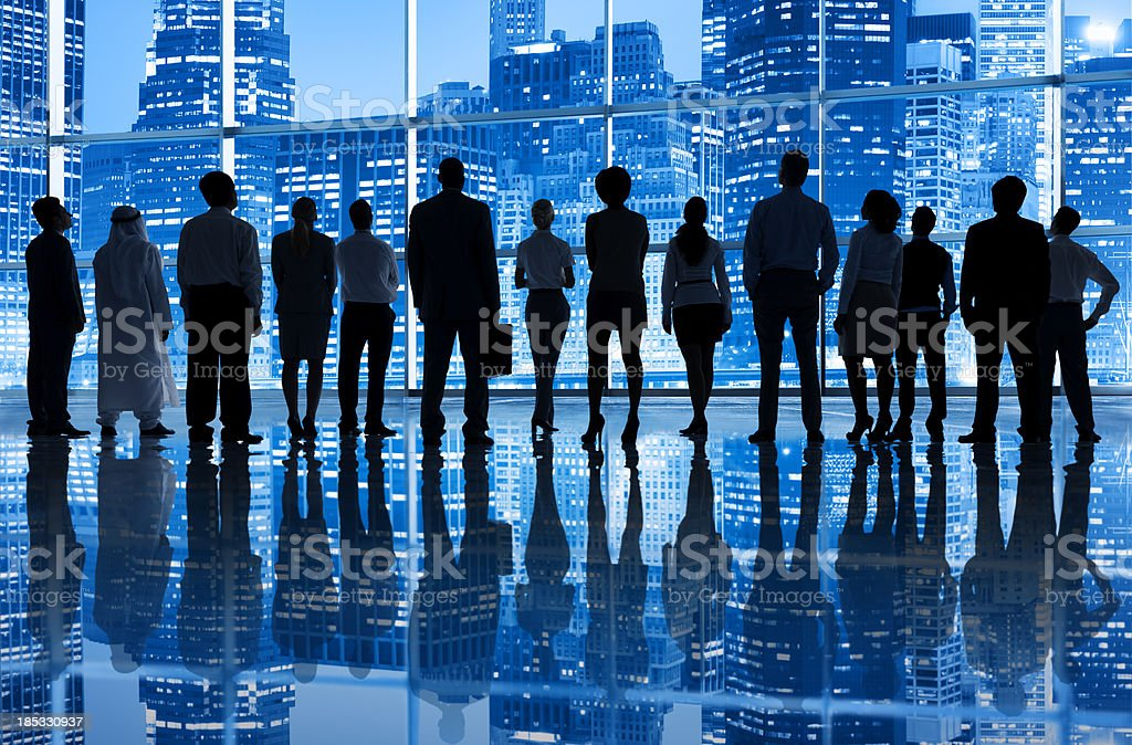 Business people starring at city skyline New York royalty-free stock photo