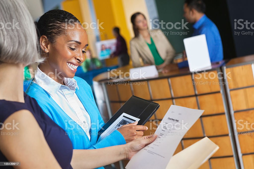 Business people studying resumes and applications at job fair royalty-free stock photo