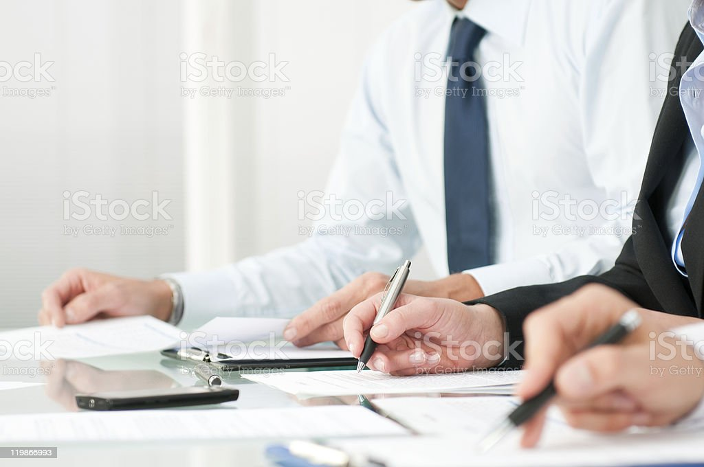 Business people taking notes stock photo