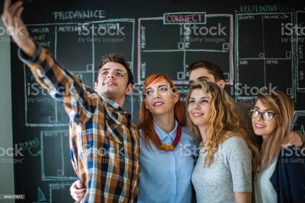Business people taking selfie of themselves in the office stock photo
