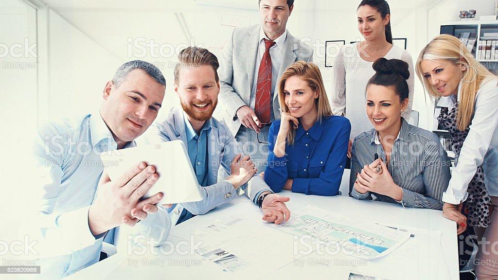 Business people taking selfies. stock photo