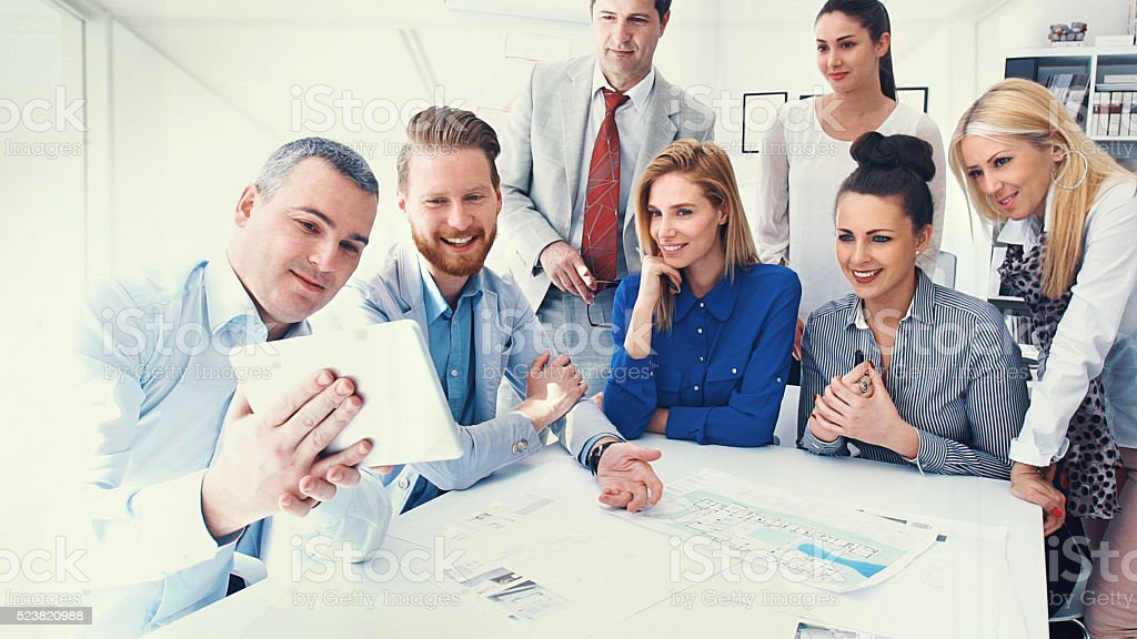 Business people taking selfies. stock photo