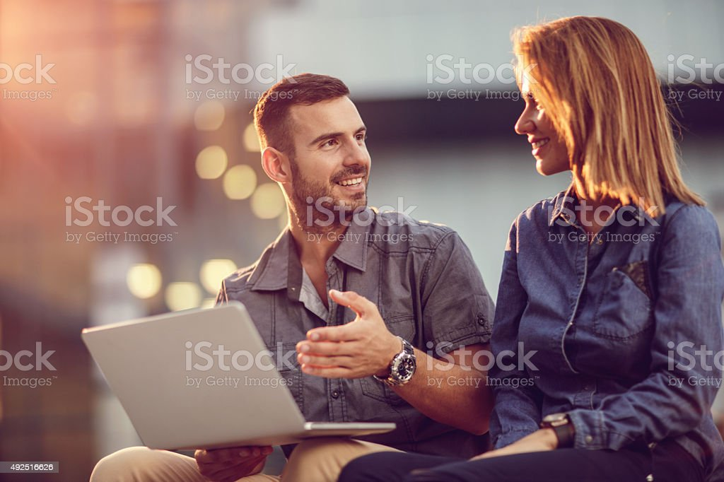 Business people talking about an e-mail they have received. stock photo