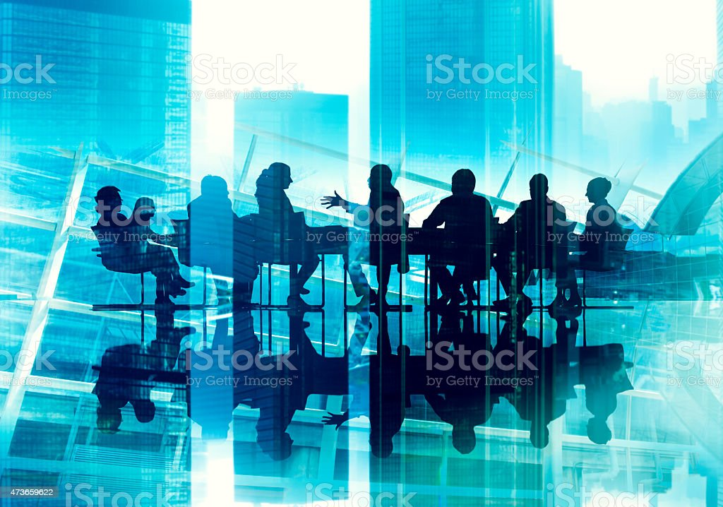 Business People Talking in a Board Room stock photo