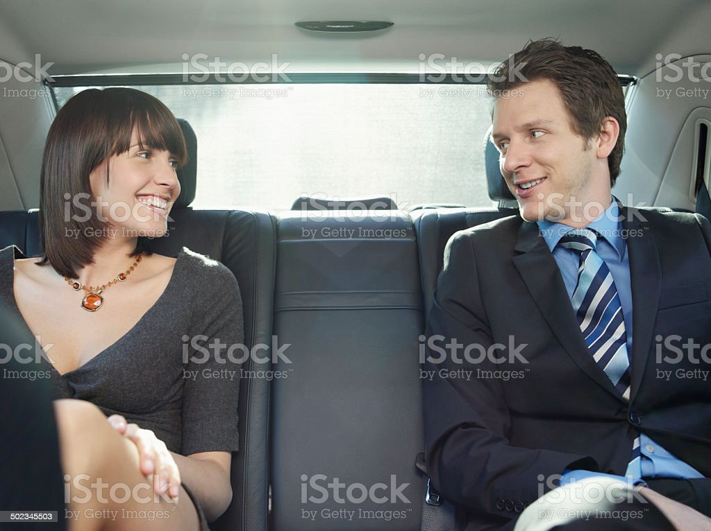 Business People Talking In Back Seat Of Car stock photo