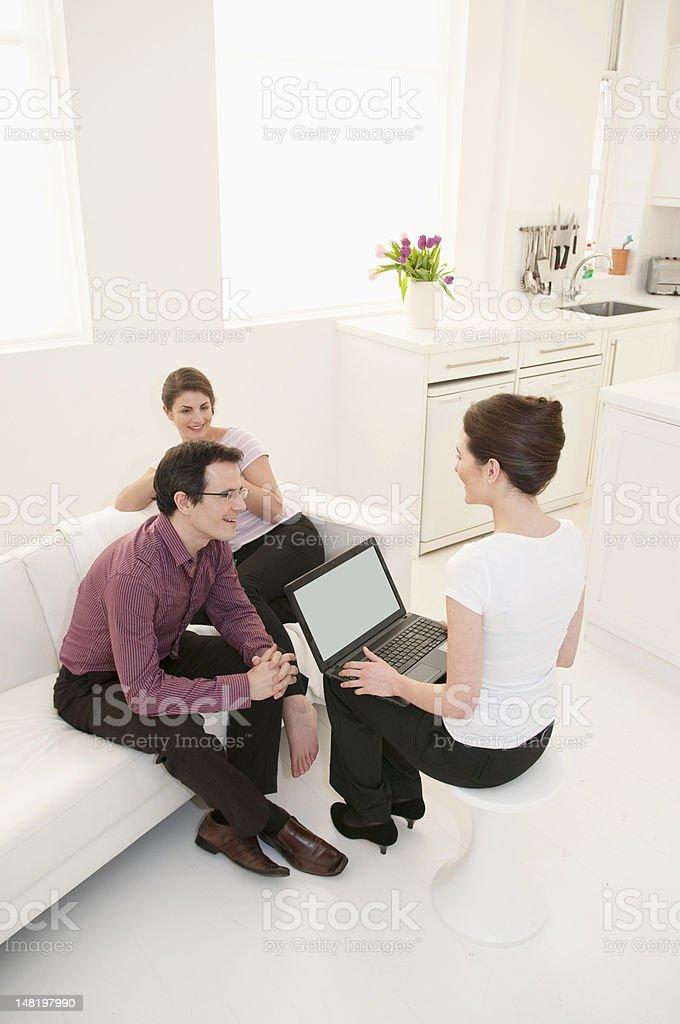 Business people talking in break room royalty-free stock photo