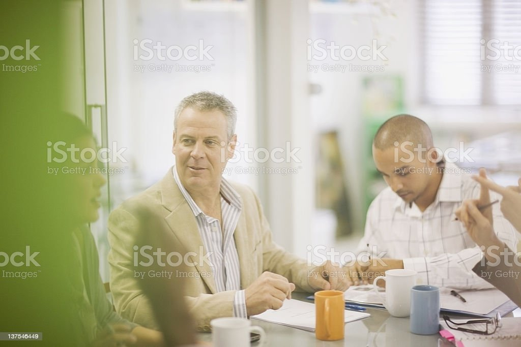 Business people talking in conference stock photo