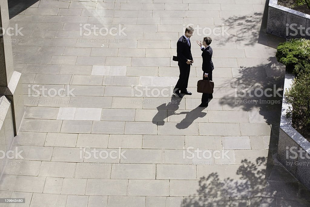 Business people talking in courtyard royalty-free stock photo