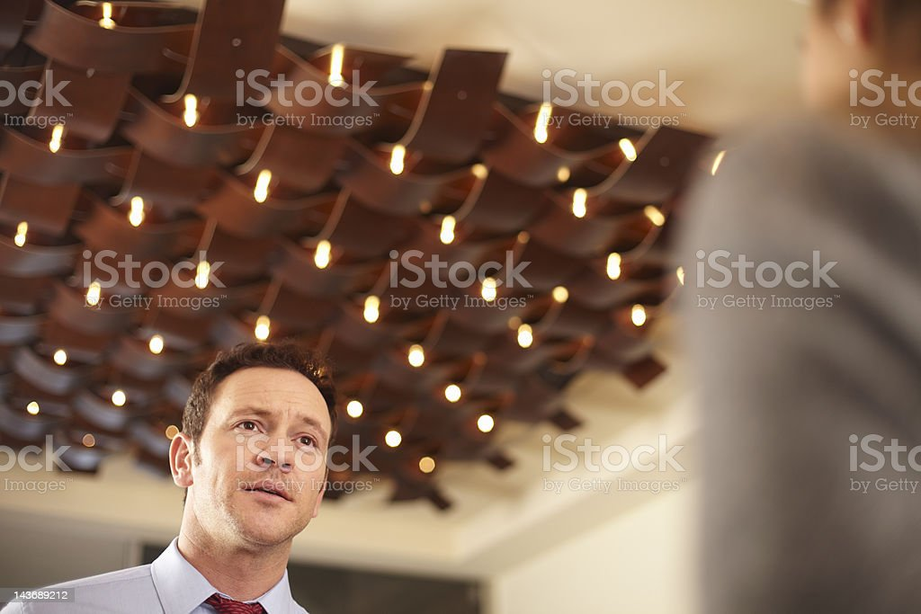Business people talking in lobby royalty-free stock photo