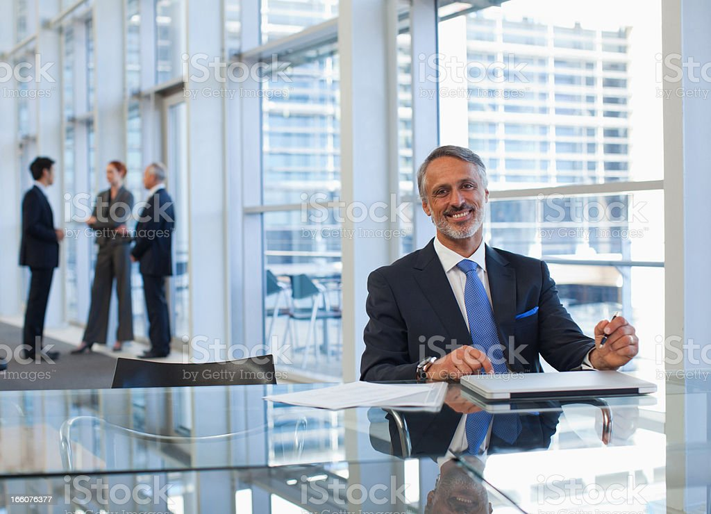 Business people talking in office lobby royalty-free stock photo
