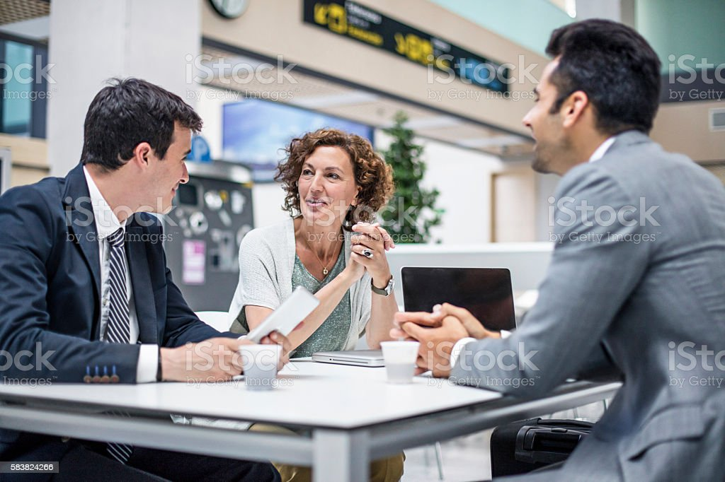 Business people talking in the airport cafeteria stock photo