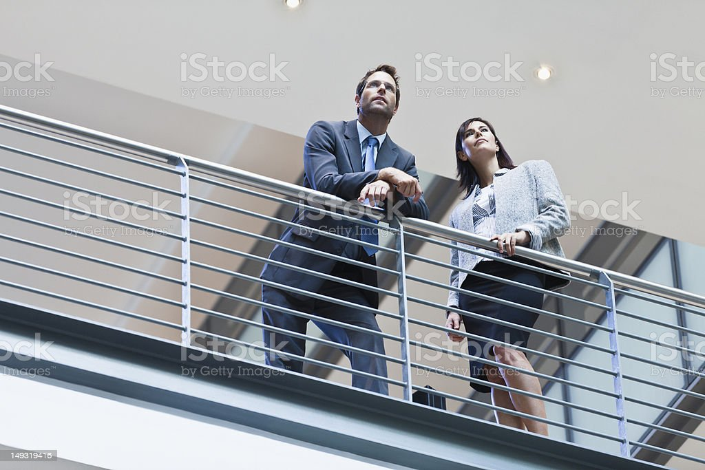 Business people talking on balcony stock photo