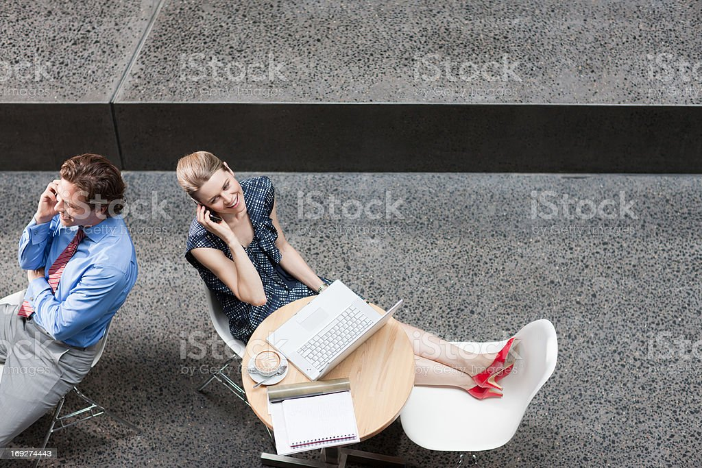 Business people talking on cell phone  royalty-free stock photo