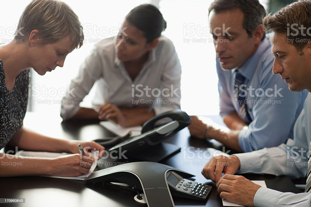 Business people talking on conference call stock photo