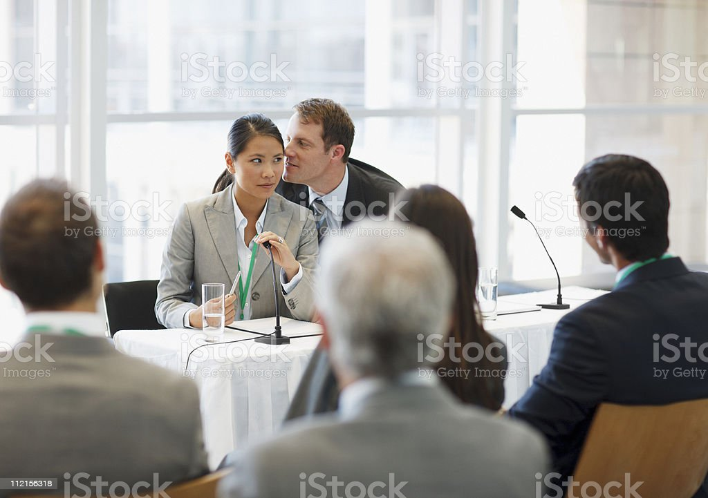 Business people talking on seminar panel in office royalty-free stock photo