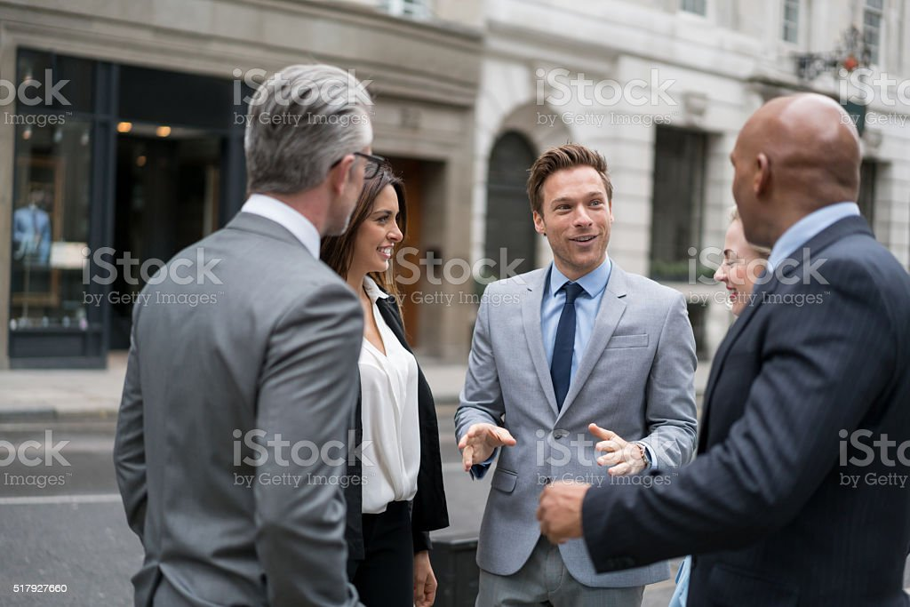 Business people talking on the street stock photo