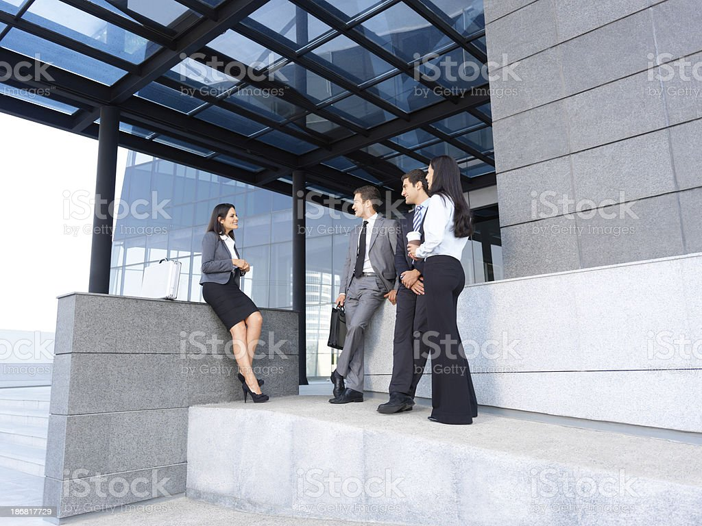 Business people talking outside office royalty-free stock photo
