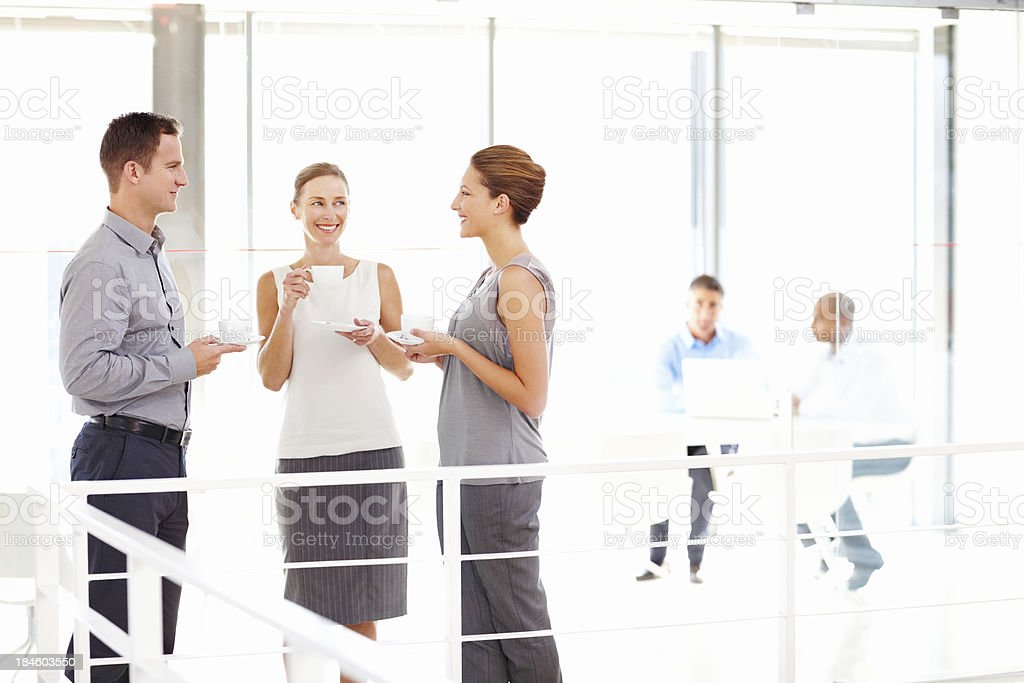 Business People Talking Over Coffee royalty-free stock photo