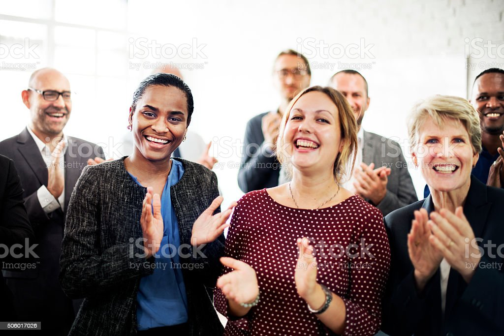 Business People Team Applauding Achievement Concept stock photo