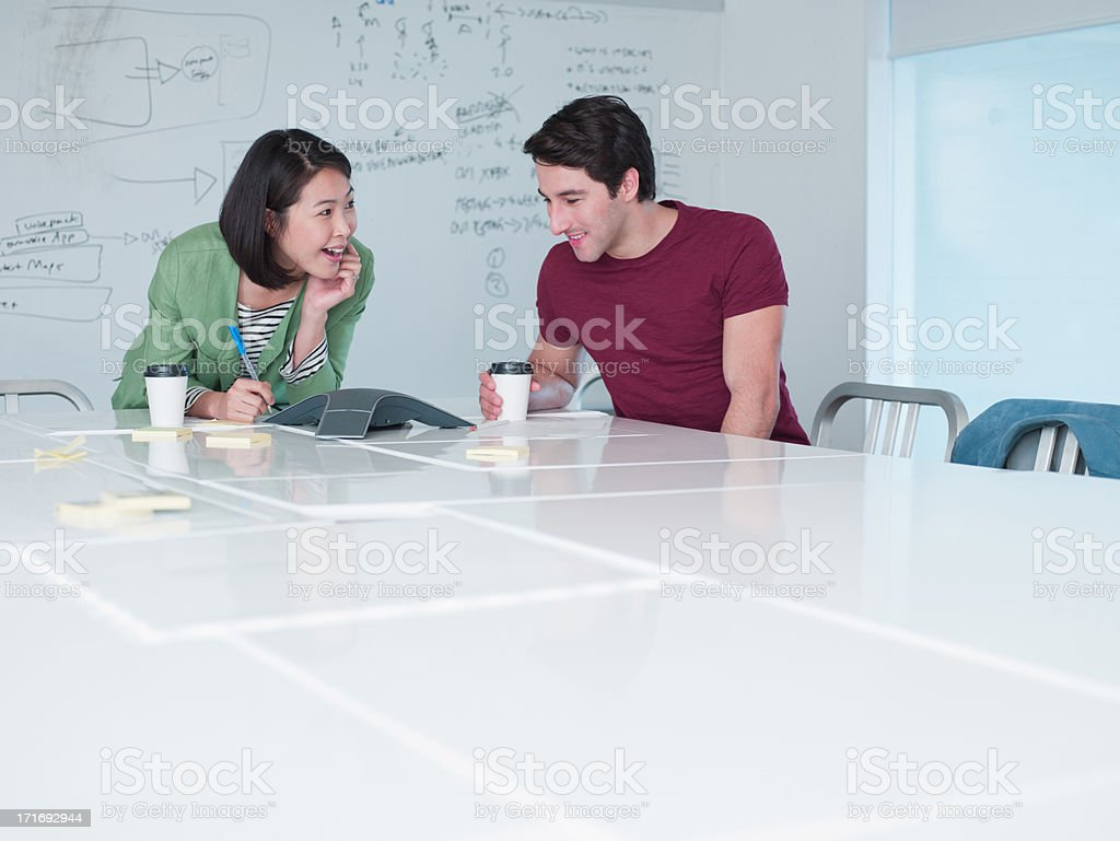 Business people teleconferencing in conference room stock photo