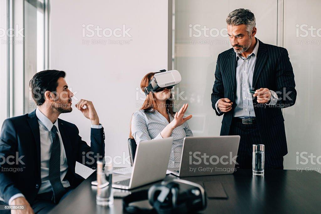 Business people testing VR simulator stock photo