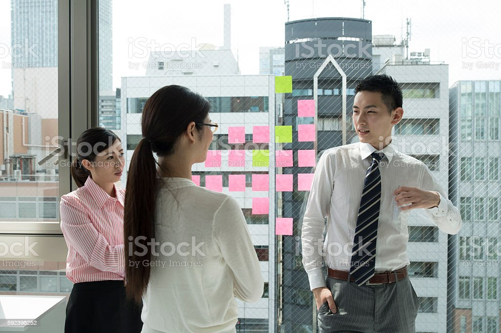 Business people to have a discussion while standing stock photo