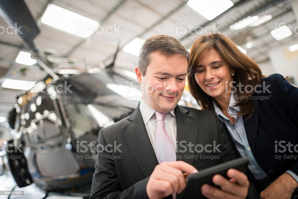 Business people traveling by helicopter stock photo