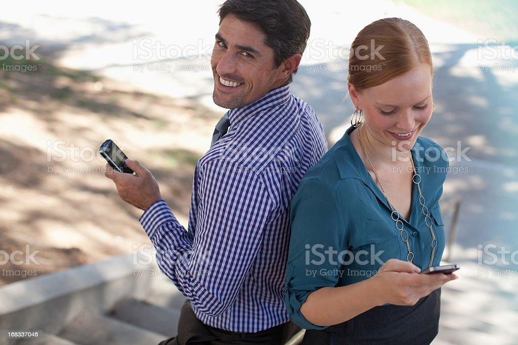 Business people using cell phones outdoors royalty-free stock photo