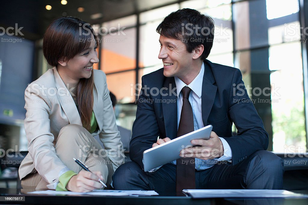 Business people using digital tablet together royalty-free stock photo