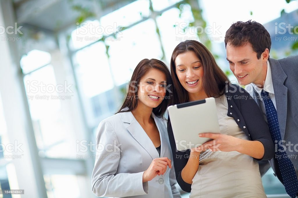Business people using electronic pad royalty-free stock photo