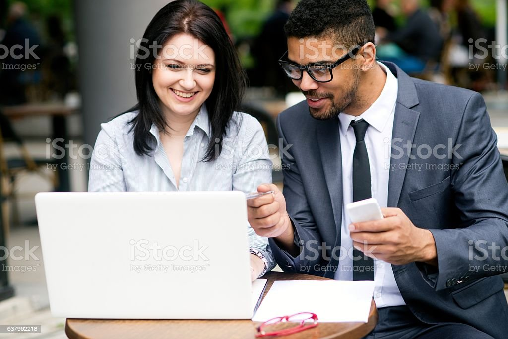 Business people using laptop. stock photo