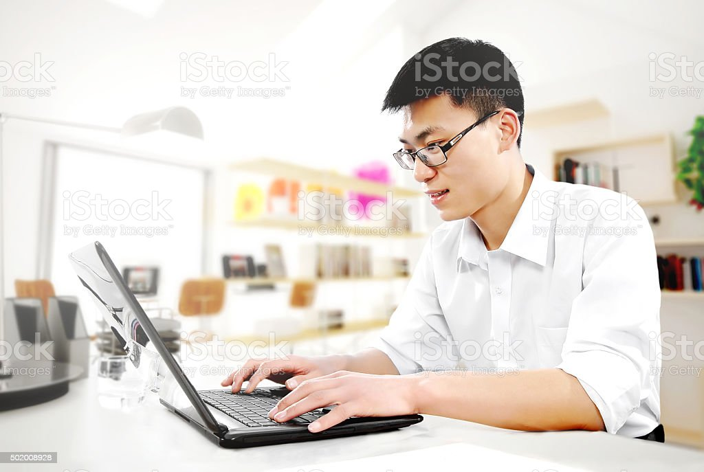 Business people using laptops in the offic stock photo