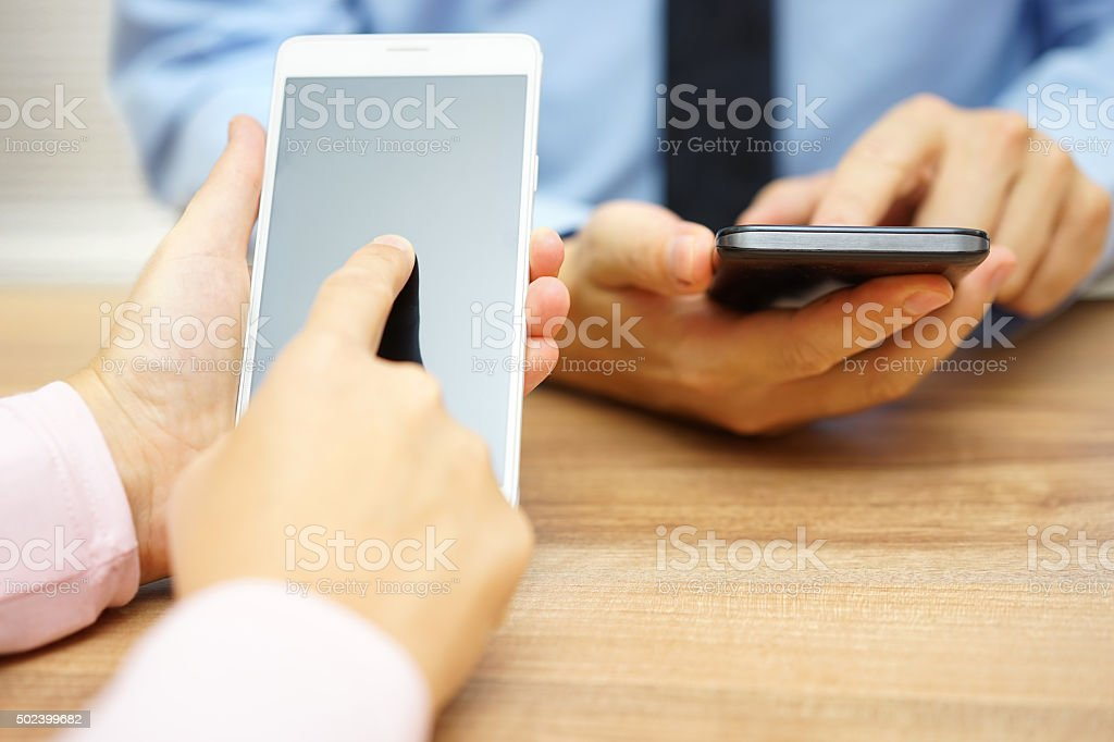 Business people using smart mobile phones at office stock photo