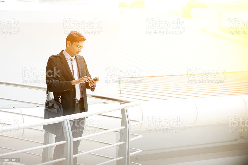 Business people using smartphone at outdoor stock photo