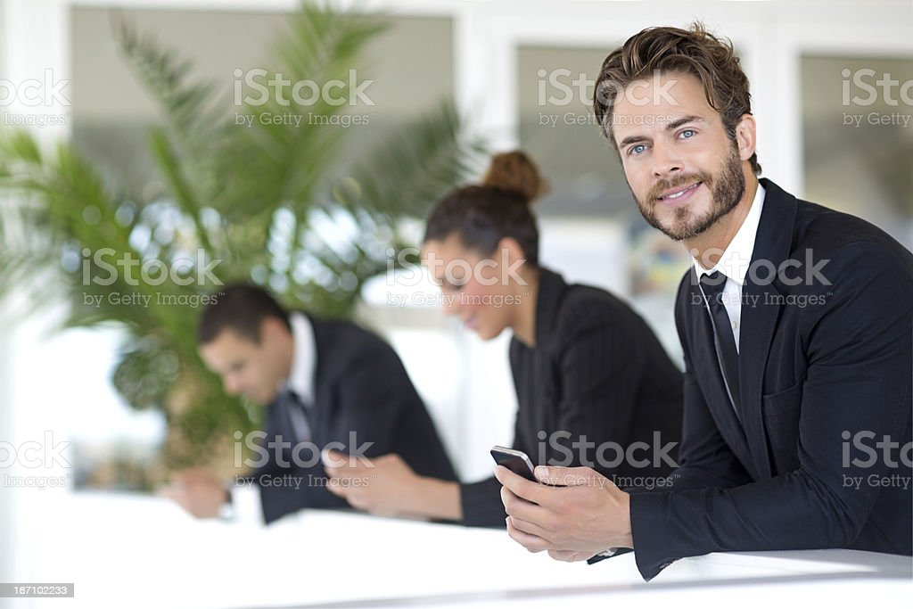 business people using smartphone stock photo