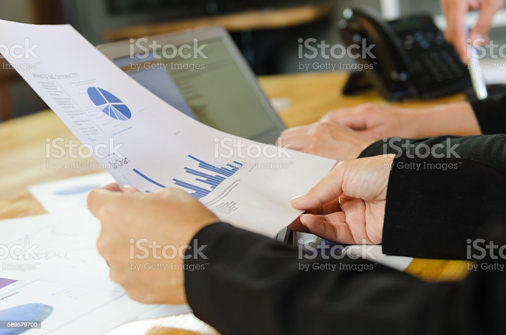 Business people view graph on paper for analysis business. stock photo