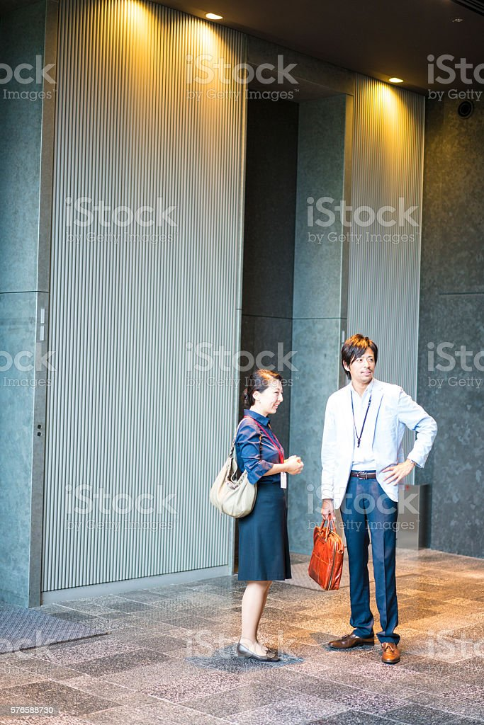 Business people waiting for elevator in Kyoto, Japan stock photo