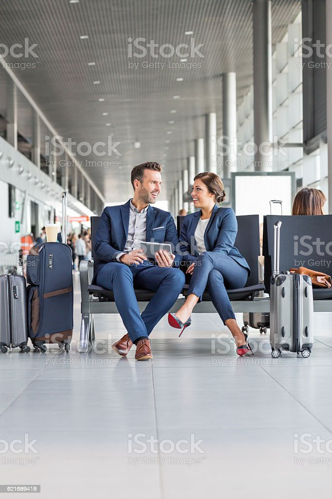 Business people waiting for flight stock photo