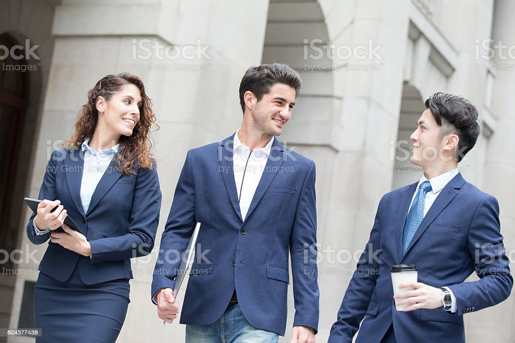 business people walk on road stock photo