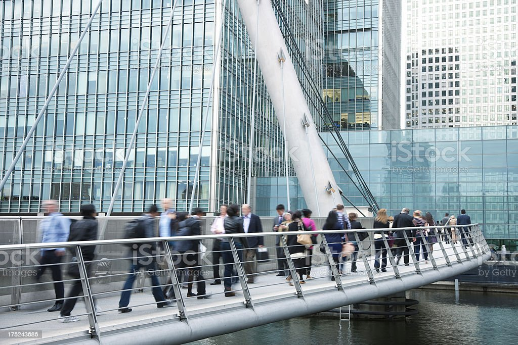 Business People Walking Across Bridge in Financial District, London, UK stock photo